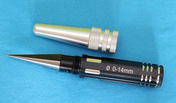 Hole puncher reamer tool
